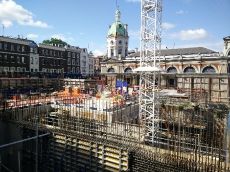 The construction site where the east ticket hall will be located, with Smithfield Market in the background.